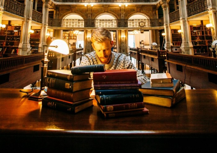 Man studying books at a library